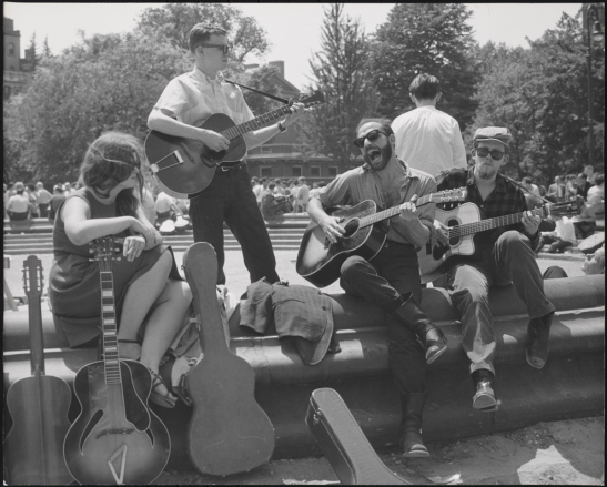 History of Greenwich Village Folk Music Bearded guitarist with other musicians, Washington Square Park