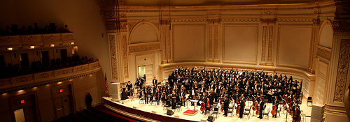 Orchestra on stage at Carnegie Hall