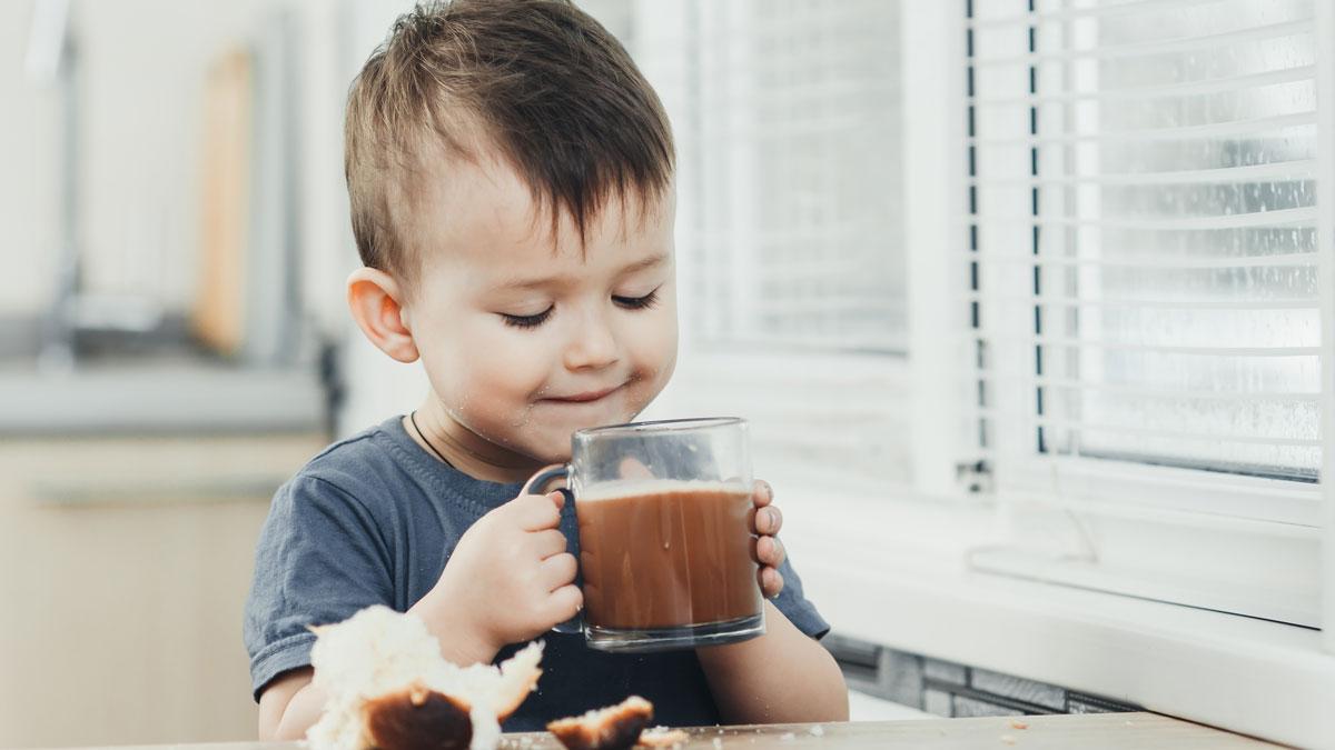 kid drinking hot chocolate